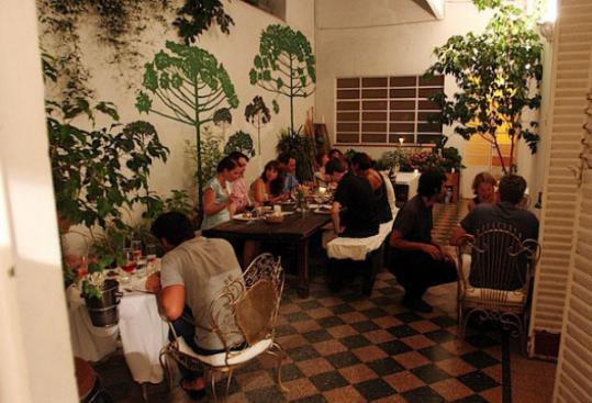In Buenos Aires, guests dine on the patio at Casa Felix, where a bowl of summer locro, a northern Argentinian stew, one night included vegetarian chorizo.