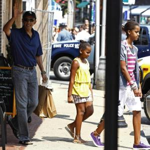 President Obama and his daughters, Sasha (center) and Malia, leave Bunch of Grapes Bookstore yesterday.