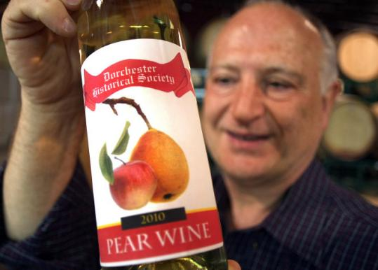 At the Boston Winery, Earl Taylor, president of the Dorchester Historical Society, displayed a bottle of the society's wine, which is made from Clapp's Favorite pears.