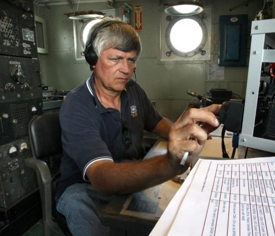 Dick McPherson worked in the radio room of the Nantucket Lightship yesterday, docked in Boston Harbor.