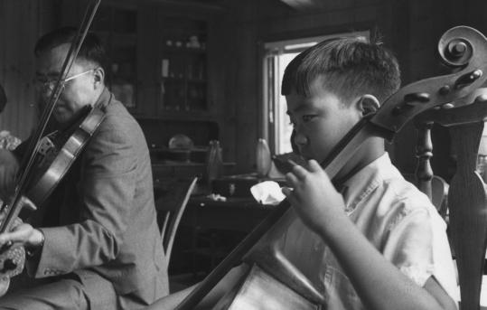 Yo-Yo Ma practicing the cello as a child.