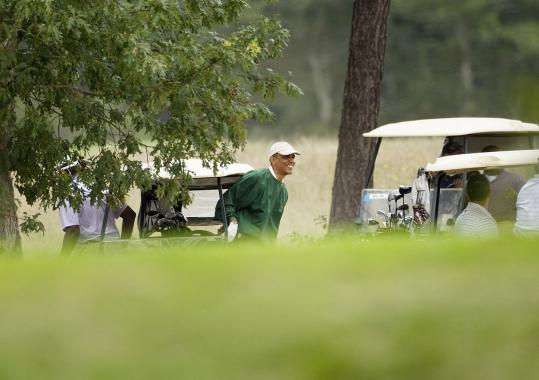 Photographers got only a distant glimpse of President Obama at the Vineyard Golf Club in Edgartown yesterday.