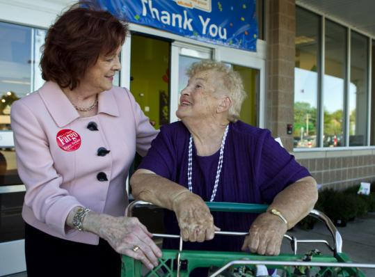 State Senator Susan Fargo (left) greeted Ellie LeBlanc of Waltham at a Shaw's market in Waltham. Fargo says she wants to repeal sales and alcohol tax hikes.