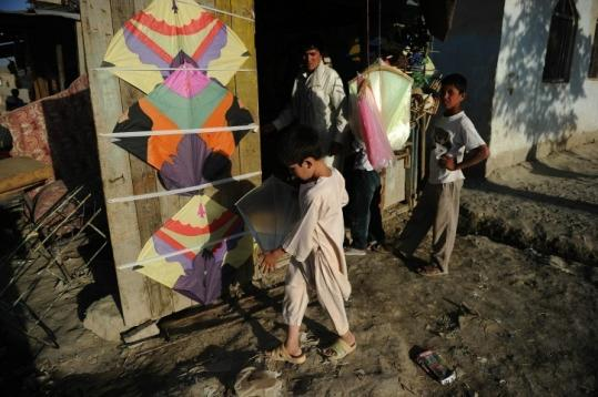 An Afghan boy bought a kite after sunset in Kabul. It is the holy month of Ramadan, when Muslims fast all day.