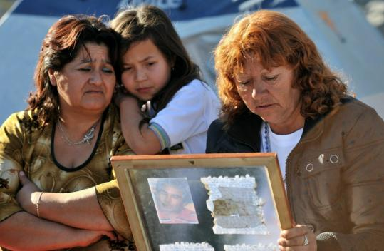 Liliana Ramirez (right) read a letter sent by her husband, Mario Gomez, one of the 33 miners trapped in a Chilean mine.