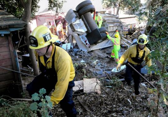 Firefighters in Santa Barbara County, Calif., searched the site where a gravel truck lost its brakes and crushed a home yesterday.
