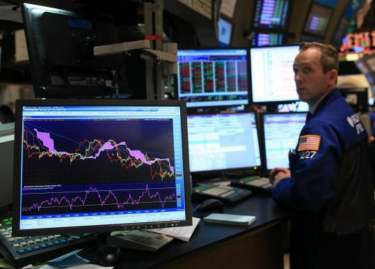 A trader worked on the floor yesterday afternoon at the New York Stock Exchange, where the Dow Jones fell 134 points to a seven-week low.