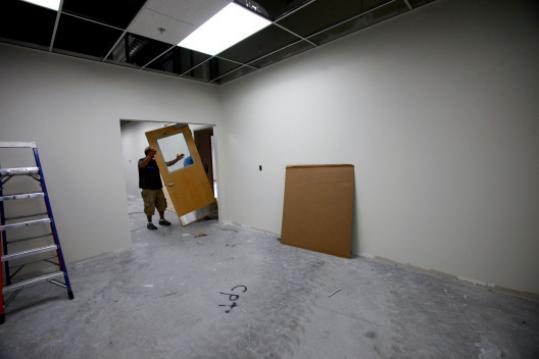 Dynisco in Franklin is moving into a smaller space with half the offices and an open look.