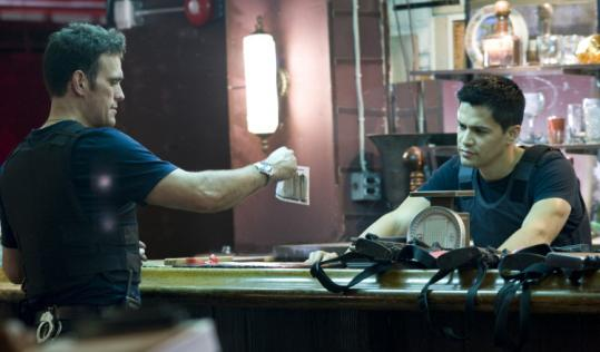 "Matt Dillon, shown with Jay Hernandez (right), plays a police detective who loves his job too much in ""Takers.''"