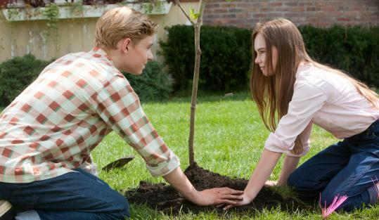 Callan McAuliffe as Bryce Loski and Madeline Carroll as Juli Baker play middle-schoolers and neighbors in a deceptively perfect 1963 suburbia.
