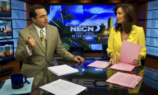"""Mike Nikitas and Karen Swensen prepared for the """"First Thing in the Morning'' newscast at NECN in Newton."""