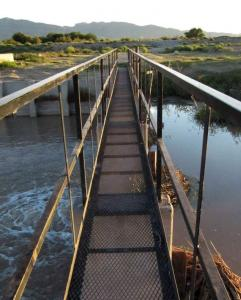 A footbridge across the Rio Grande near Acala, Texas, connects the United States and Mexico. It was built in the 1930s.