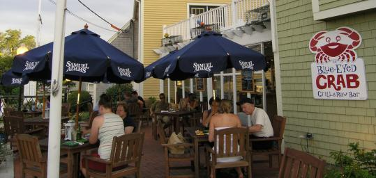 There&#8217;s outdoor seating at the Blue-Eyed Crab with a view of Plymouth Harbor. Appetizers include (left) steamed mussels with sticks of toasted baguette, and crab two ways.