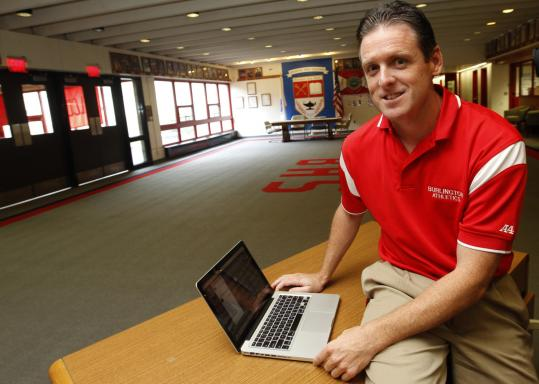 Burlington High principal Patrick Larkin plans for a day when every student will have a laptop computer and be well versed in high-tech equipment.