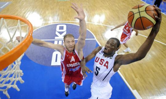 Croatia's Luka Zoric is too late to prevent Kevin Durant from getting an easy look. Durant had 14 points and eight rebounds.
