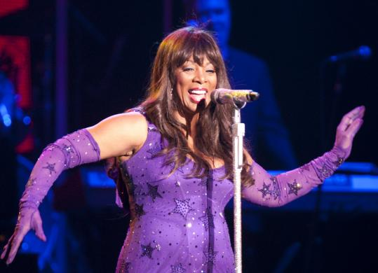 Donna Summer was accompanied by a nine-piece band, three dancers, and enthusiastic ovations from the audience Friday night at the Bank of America Pavilion.