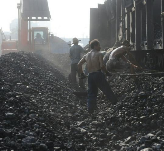 Miners unloaded coal from a train in Eastern China earlier this month. Coal is used heavily in China and India.