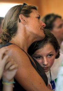 Michelle Sullivan, whose husband died 3 1/2 years ago, comforted her daughter, Isla, during the closing ceremony at the bereavement camp yesterday in Sandwich.