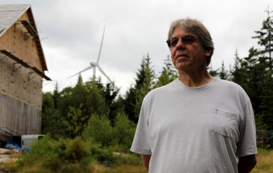 Art Lindgren, an opponent of the wind farm, measures the noise from nearby wind turbines twice a week with his own equipment.