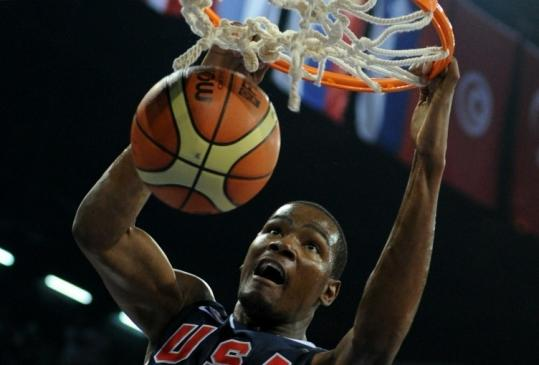 Kevin Durant finishes off a dunk during the US team&#8217;s victory over Slovenia in preliminary-round play.