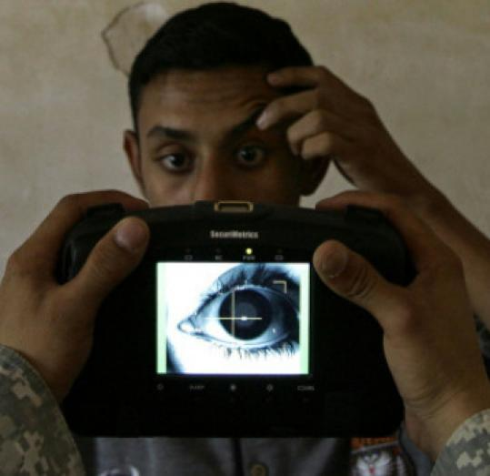A US soldier digitally scanned the iris of a man hoping to enlist in an Iraqi unit.