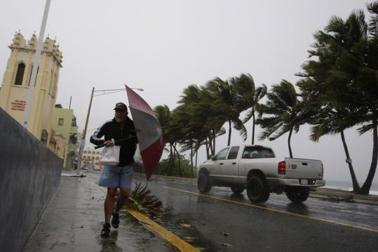 Hurricane Earl lashed San Juan with heavy winds and rain yesterday. Weather experts say it is too early to know what effect the storm will have on the United States.