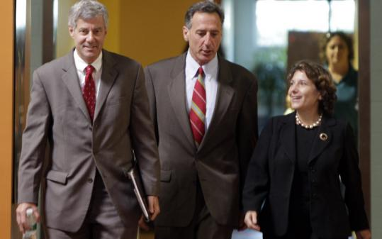 Doug Racine (left), Peter Shumlin, and Deb Markowitz made their way to a press conference yesterday in which they criticized an economic recovery plan issued by Lieutenant Governor Brian Dubie, a Republican. Racine trails Shumlin by 197 votes.