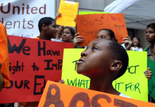 Darius Satchebell, 8, a Roxbury third-grader, and other public school students gathered at the school department yesterday to call for longer school days, among other changes.