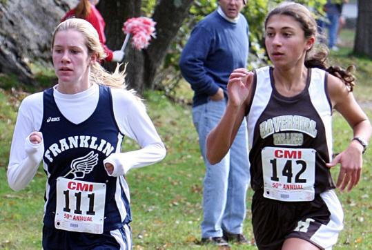 Haverhill High's Julie Solimine (right), who excels as a distance runner, edged a Franklin runner in a cross-country race at Franklin Park last fall.