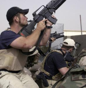Contractors working for Blackwater take part in a firefight in Iraq in 2004.