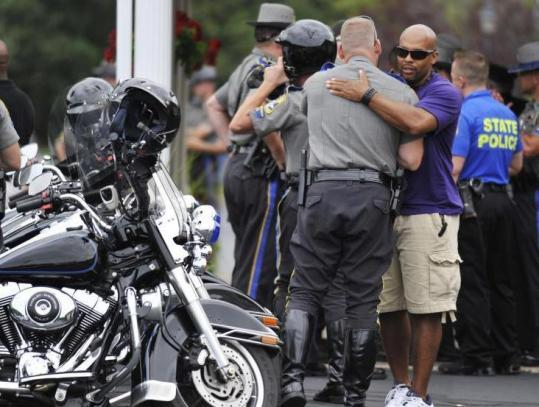 Connecticut police gathered outside a Windsor, Conn., funeral home yesterday, after the arrival of Kenneth Hall's body.