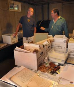 Historian Bill Ralph and auctioneer Richard Oliver chatted amid the items that belonged to Worcester native A.H. Green.