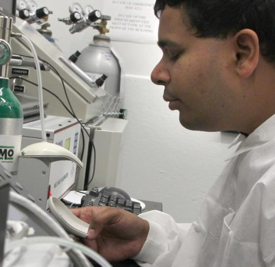 Neeraj Dalal evaluates sensors at QinetiQ North America in Waltham. Their size is a big issue.