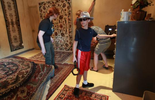 "Robbie Russo, 10, in the rug shop ""front'' of Espionage at Patriot Place."
