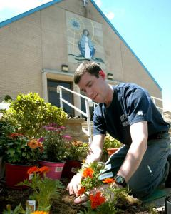 Parishioner Sean Glennon, shown planting flowers at Mary Star of the Sea Chapel, lamented not having time to prepare.