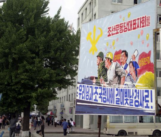 A poster on a street in Pyongyang promoted this month's Workers' Party conference. The date and time it opens have been kept secret, as is typical in North Korea.