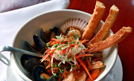 Shellfish soup consists of shrimp, scallops, clams, and mussels in their shells.