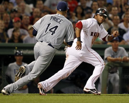 Rays pitcher David Price (left) has Darnell McDonald in a rundown after grabbing a third-inning comebacker, and McDonald was tagged out.