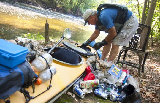 Three days a week, Al Peirce, who lives in Acton, collects trash as he kayaks the Assabet, Sudbury, and Concord rivers.