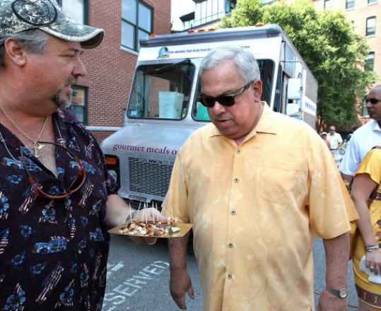 Mayor Thomas M. Menino considers a sample at the first Boston Food Truck Festival last month.