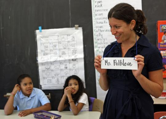 Second-grade teacher Lisa Poltilove talked with students on the first day of school at the Blackstone Elementary.