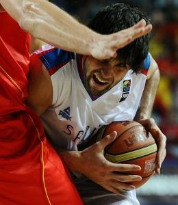 Serbia's Milos Teodosic was tightly guarded on this play, but got free long enough to hit the winning basket.