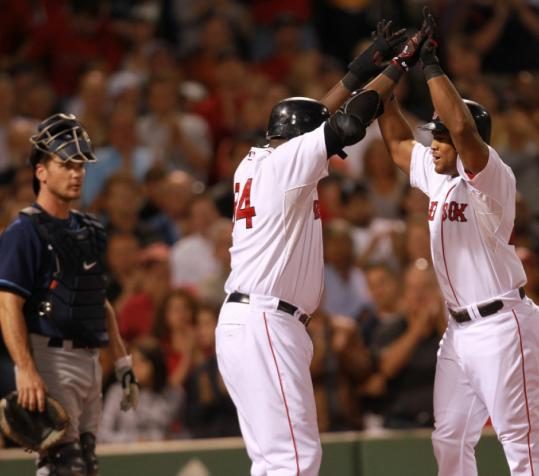 Trailing, 4-0, in the second, Adrian Beltre (right) got the Red Sox on the board with a two-run homer that also scored David Ortiz (center).