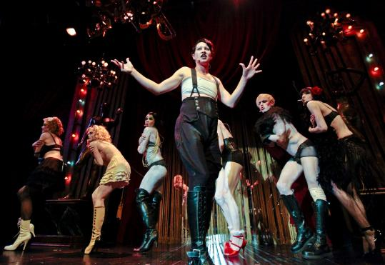 While her performance doesn't register much at first, by the end of Act 1, Amanda Palmer (center) as the Emcee, gains confidence and asserts herself more.