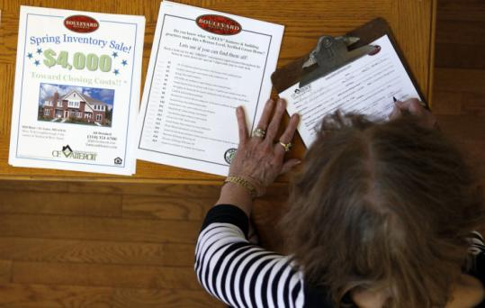 Anne Schaeffer filled out a form to receive more information after touring a new home for sale Aug. 25 in St. Louis.