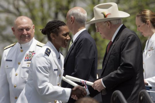 Dick Cheney, then the vice president, congratulated Coast Guard Academy cadet DeCarol Davis during 2008 graduation ceremonies and handed her a commission as an ensign.