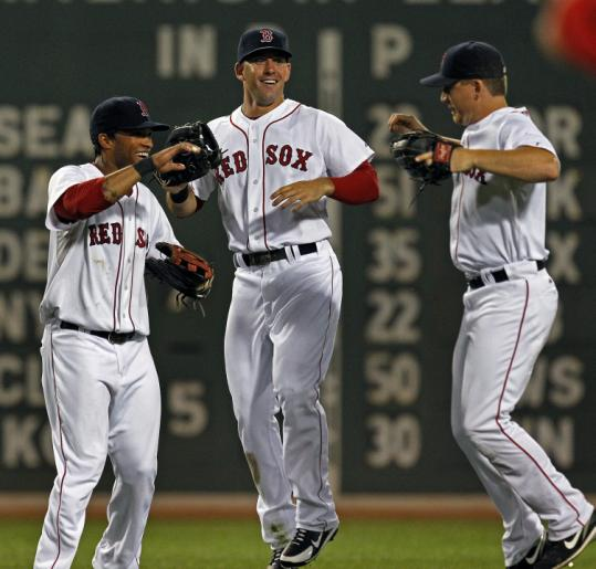 Darnell McDonald (left), Ryan Kalish (center), and J.D. Drew were just one of the Sox' 42 starting outfields this year.