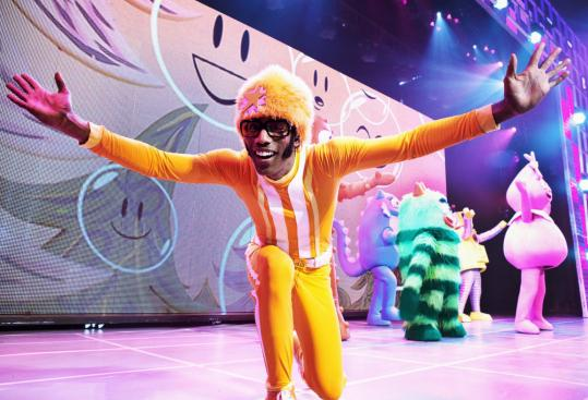 DJ Lance Rock and a bunch of colorful creatures entertain the crowd in a show featuring rock music and hip-hop beats.