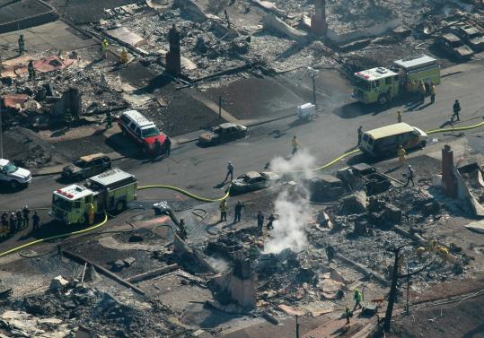 Firefighters sifted through rubble yesterday at a home destroyed by a massive explosion and fire in San Bruno, Calif.