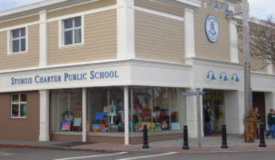 Sturgis Charter Public School in Hyannis (above) is housed in a converted furniture store on Main Street, but its students manage to stage dramatic productions, play sports, and stay nourished, despite not having all the amenities that newNewton North High School boasts.